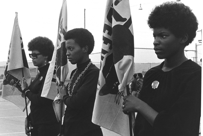 Women drilling with Panther flags. Photo courtesy of Pirkle Jones and Ruth-Marion Baruch.